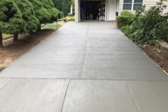 GM Concrete Drive Way Featuring The GM Trade Mark Look